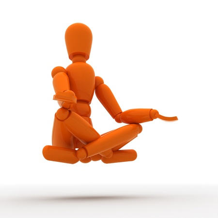 levitating: Orange mannequin is levitating. Stock Photo
