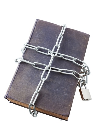 The old book tied up by a chain and closed on the lock. Symbolises forbidden knowledge or censorship.  photo