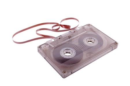Old transparent plastic audio cassette with brown (ferric oxide) tape for domestic magnetic-tape reader.Similar cassette were in use in 1960-1990. Sometimes it was used as an alternative computer storage medium like floppy disk.  Stock Photo - 8426303