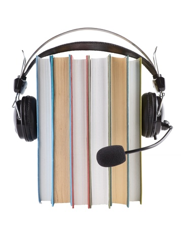 Books stack and headset with a microphone isolated on white photo