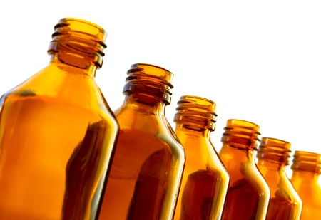dimming: Row of medical bottles Stock Photo