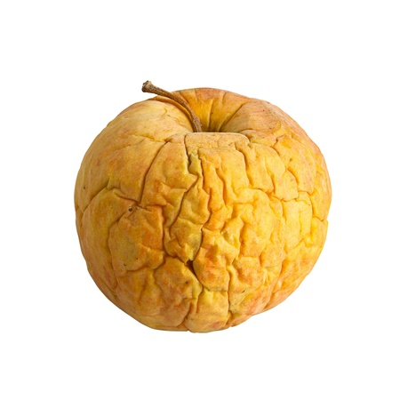 riffle: yellow wrinkled apple. aging skin concept Stock Photo
