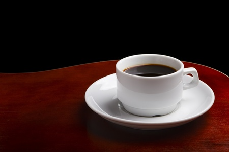 White Coffee Cup on dark brown wooden table Stock Photo - 8583773