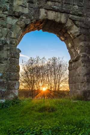 Rome (Italy), The Aqueduct Park at sunset. - Aqueducts Park is an archeological public park in Rome, part of the Appian Way Regional Park, with monumental ruins of Roman aqueducts. Stock Photo