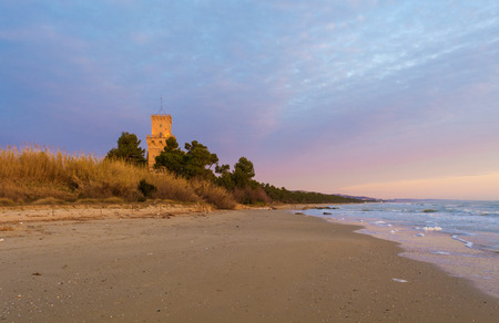 Pineto, Italy - 12 March 2017 - The sunrise on the Adriatic sea, Pineto from the beach, beside the Tower of Cerrano castle