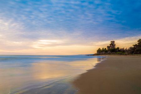 Pineto (Abruzzo, Italy) - The sunrise on the Adriatic sea, Pineto from the beach, beside the Tower of Cerrano castle