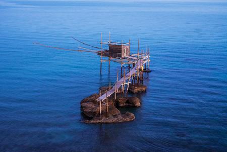 Punta Aderci, Vasto - Trabocchi Coast in the Abruzzo region (Italy), wooden architecture on the sea at sunrise. Stock Photo