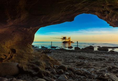 Punta Aderci, Vasto - Trabocchi Coast in the Abruzzo region (Italy), wooden architecture on the sea at sunrise. Reklamní fotografie - 76317880
