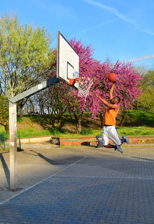 Rome, Italy - 10 April 2015 - A spring afternoon in the famous and multiethnic basketball playground of the San Lorenzo district in Rome