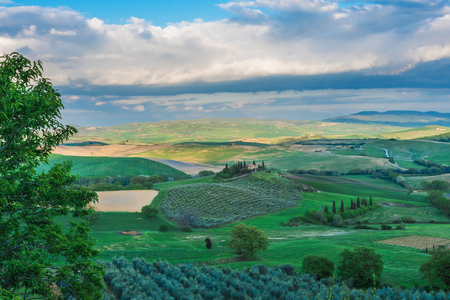 Val dOrcia, Italy - 23 April 2017 - The wonderful and very famous landscape of the Tuscany region, during the spring. All the places and landscapes of the Val dOrcia are protected by copyright, following the recognition of the request of the town of San