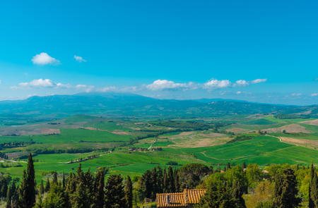 san quirico d'orcia: Val dOrcia, Italy - 23 April 2017 - The wonderful and very famous landscape of the Tuscany region, during the spring. All the places and landscapes of the Val dOrcia are protected by copyright, following the recognition of the request of the town of San