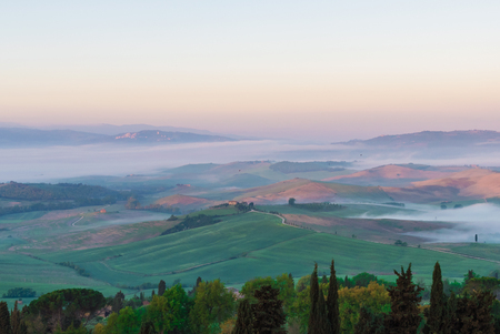 Val dOrcia, Italy - 24 April 2017 - The wonderful and very famous landscape of Tuscany region, during the spring. All the places and landscapes of the Val dOrcia are protected by copyright, following the recognition of the request of the town of San Qui