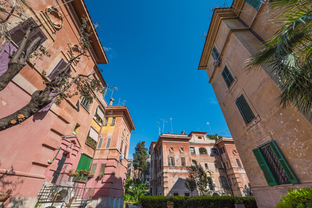 Rome, Italy - 15 April 2017 - The suggestive popular Garbatella quarter in Ostiense district, an agglomeration in Rococo style with gardens and the famous modern bridge named Settimia Spizzichino Editorial