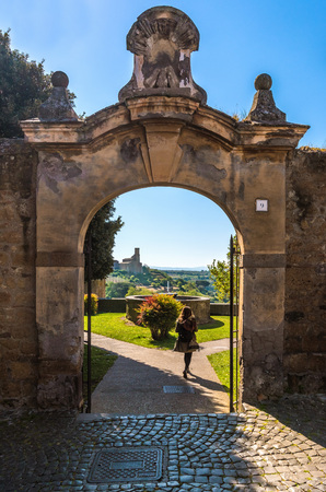 alte: Tuscania, Italy - 21 April 2017 - A gorgeous Etruscan and medieval town in the province of Viterbo, Tuscia, Lazio region. Its a tourist attraction for the many churches and the lovely historic center.