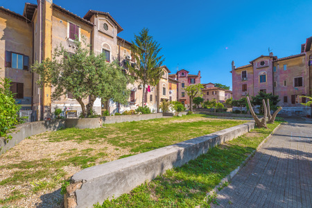 Rome, Italy - 15 April 2017 - The suggestive popular Garbatella quarter in Ostiense district, an agglomeration in Rococo style with gardens Editorial