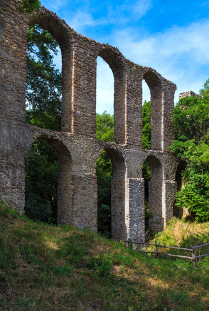 Monterano (also known as Ancient Monterano) is a ghost town in Italy, located in the province of Rome, perched on the summit plateau of the hill tuff. Stock Photo
