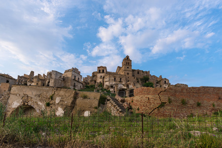 Craco (Italy) - The evocative ruins and landscapes of the ghost town scattered among the badlands hills of the Basilicata region, beside Matera, destroyed by a landslide and abandoned.