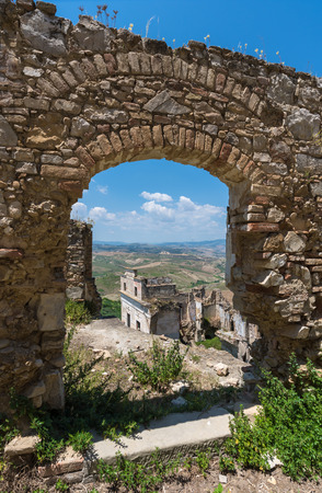 evocative: Craco (Italy) - The evocative ruins and landscapes of the ghost town scattered among the badlands hills of the Basilicata region, beside Matera, destroyed by a landslide and abandoned.