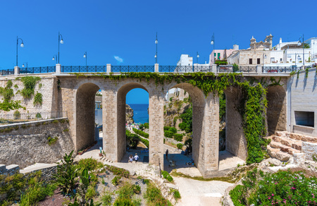 poetic: Polignano a Mare (Apulia, Italy) - The famous sea town in the province of Bari, southern Italy. The village rises on the rocky spur over the Adriatic Sea, and is known tourist attraction.