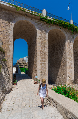 poetic: Polignano a Mare, Italy - 24 June 2017 - The famous sea town in the province of Bari, southern Italy, Puglia region. The village rises on the rocky spur over the Adriatic Sea, and is known tourist attraction.
