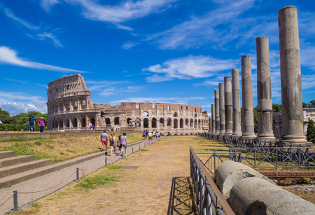 Rome, Italy - 2 July 2017 - Archaeological ruins in the historic center of Rome, named Imperial Fora, with the Colosseum, the Vittoriano monument and the Roman Forum