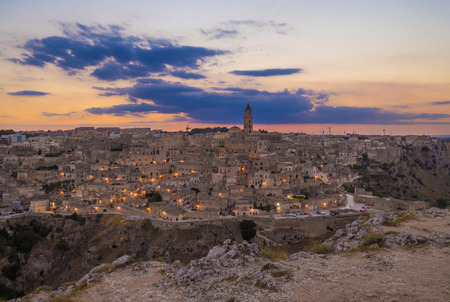 Matera (Basilicata) - The historic center of the beautiful stone town of southern Italy at sunset, a tourist attraction for the famous Sassi old town.