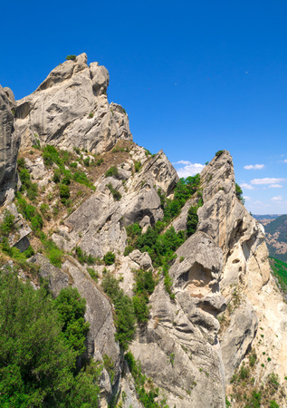 evocative: Castelmezzano (Italy) - A small altitude village, dug into the rock in the natural park of the Dolomiti Lucane, Basilicata region, also famous for the spectacular Angel flight Stock Photo
