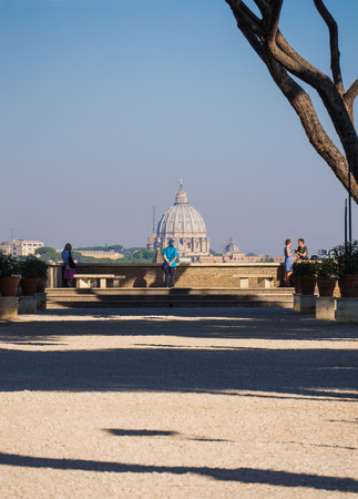 Rome, Italy - 6 August 2017 - The terrace named Orange Garden (in Italian Giardino degli Aranci) in Aventino hill, overlooking the Saint Peter dome and the famous keyhole of Cavalieri di Malta square.