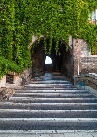 Rome, Italy - 6 August 2017 - The Staircase or Climb of the Borgia, one of the most suggestive corners of Italys Capital