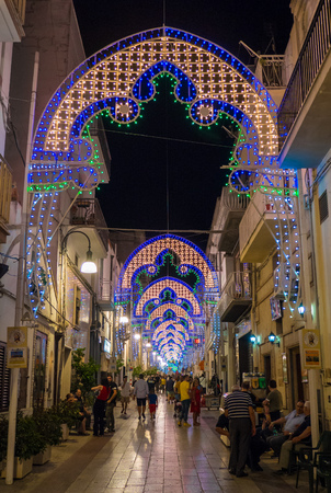 Pisticci, Italy - 14 August 2017 - A white town on the badlands hills, in the province of Matera, Basilicata region, southern Italy during the Saint Rocco patron feast