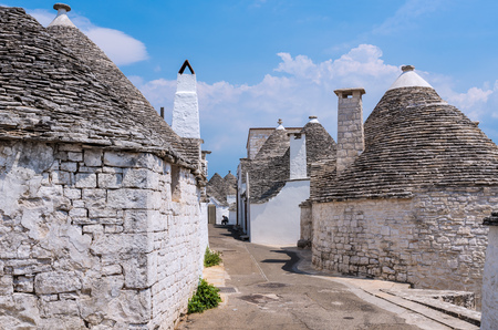 Alberobello, Italy - 2 June 2017 - The incredible little white town of Apulia, province of Bari, southern Italy, famous for its unique trulli buildings. Here the historic center is in a summer day