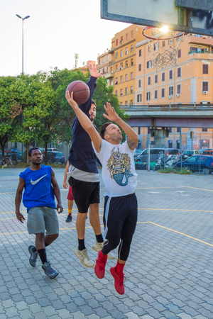 Rome, Italy - 7 October 2017 - An autumnal afternoon in the famous and multiethnic basketball playground of the San Lorenzo district in Rome. Here more players in action during a game.