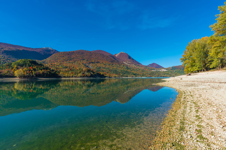 The Autumn with the Foliage in the National Park of Abruzzo, Lazio and Molise (Italy) - An ancient Italian mountain reserve, with little old towns, the Barrea Lake, Camosciara, Acacia, Val Fondillo Stock Photo