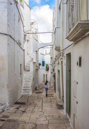 Cisternino, Italy - 28 September 2017 - The historic center of the small and pretty white town of the province of Brindisi, Apulia region, southern Italy