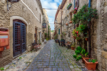 Bolsena, Italy - 18 November 2017 - The old town of Bolsena on the namesake lake. An autumnal visit in the medieval historic center and at the port.