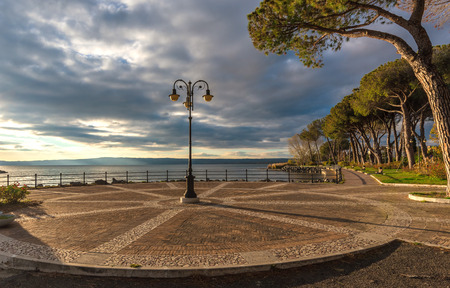Bolsena lake (Italy) - The lake front and the port of Bolsena medieval town, at sunset