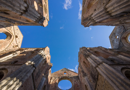 Abbey of Saint Galgano, Italy - 26 November 2017 - An old cistercian catholic monastery in a isolated valley of Siena province, Tuscany. The roof collapsed after a lightning strike on the bell tower.