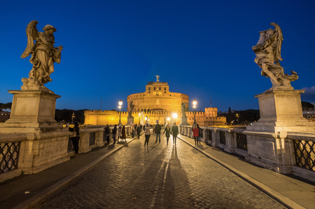 Rome, Italy - 1 December 2017 - TCastel SantAngelo monument with statues in blue hour