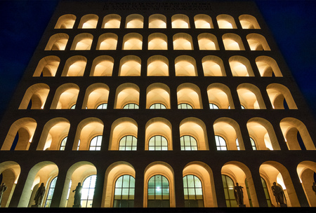 Rome, Italy - 8 December 2017 - The Palazzo della Civiltà Italiana of EUR district in the night, also know as Square Colosseum, icon building of New Classical and Fascist architecture, now museum