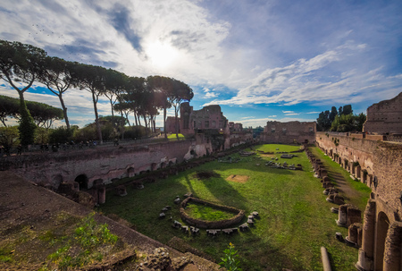 Rome, Italy - 3 December 2017 - The archeological ruins with Colosseum in historic center of Rome, named Imperial Fora. Here in particular the Foro Romano on Palatino hill. Editorial