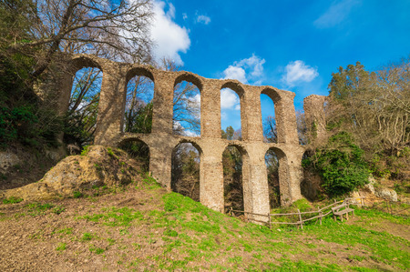 Monterano (Italy) - A ghost medieval town in the country of Lazio region, located in the province of Rome, perched on the summit plateau of the hill tuff. Reklamní fotografie - 95235680