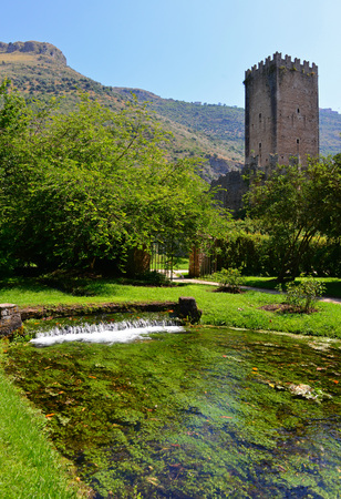 Garden of Ninfa, Italy - 22 June 2014 - A natural monument with medieval ruins in stone, flowers park and an awesome torrent with little fall. Province of Latina, Lazio region, central Italy.