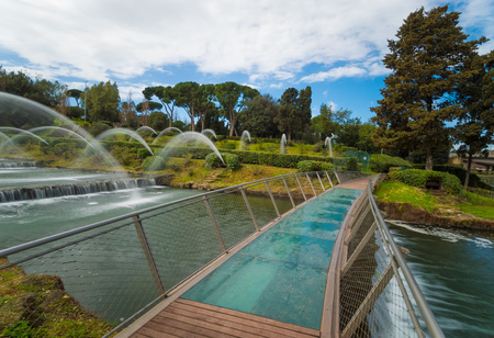 Rome, Italy - 31 March 2018 - The artificial waterfall in the big fountain of EUR artificial lake, modern district in the south of Rome Éditoriale