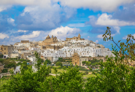 Ostuni (Puglia, Italy) - The gorgeous white city in province of Brindisi, Apulia region, Southern Italy, with the old historic center on the hill and beside the sea