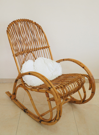 Rocking chair in wood, with cushions Stock Photo