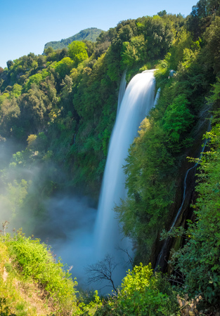 Marmore (Terni), Italy - 21 April 2018 - The 'Cascata delle Marmore' is a touristic park with a man-made waterfall created by the ancient Romans. The fall of Velino river in total is height 165 meters.