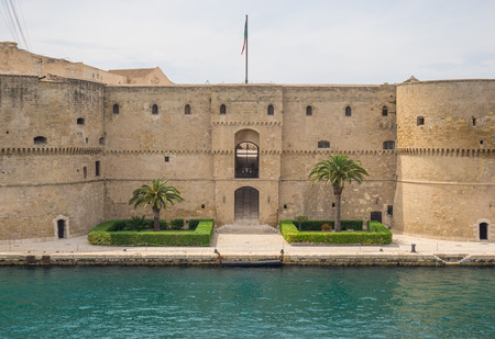 Taranto, Italy - 28 April 2018 - The historic center of a big city in southern Italy, on the sea with industry port, in a spring day. Here in particular the castle on the sea
