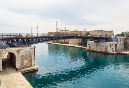 Taranto, Italy - 28 April 2018 - The historic center of a big city in southern Italy, on the sea with industry port, in a spring day. Here in particular the bridge to old town