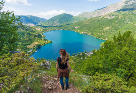 Scanno, Italy - 2 June 2018 - When nature is romantic: the heart - shaped lake on the Apennines mountains, in Abruzzo region, central Italy, with tourist Editorial