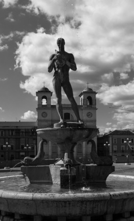 L'Aquila, Italy - 12 September 2015 - The historic center of Abruzzo capital, central Italy, destroyed by an earthquake in 2009, now under reconstruction. Here the monumental fountain. Editorial